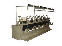 Automatic cheese winding machine