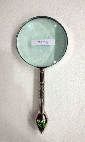 Magnifying glass with brass designed handle