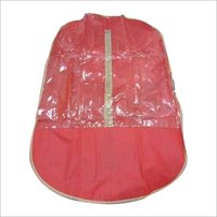 Red suitcover with beigh piping round shape