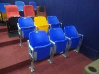 Tip up stadium chairs