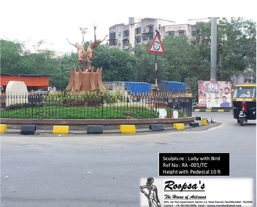 Lady with Bird Traffic Circle sculpture