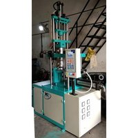 Servo type vertical injection moulding machine