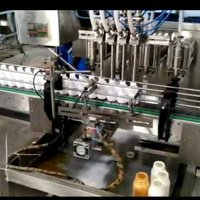 Four head bottle filling machine