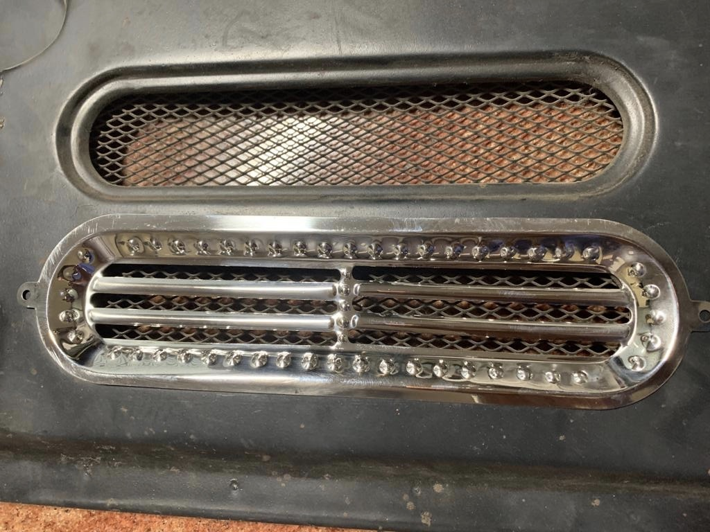 128 - REAR DOOR GRILL SHOW COVER