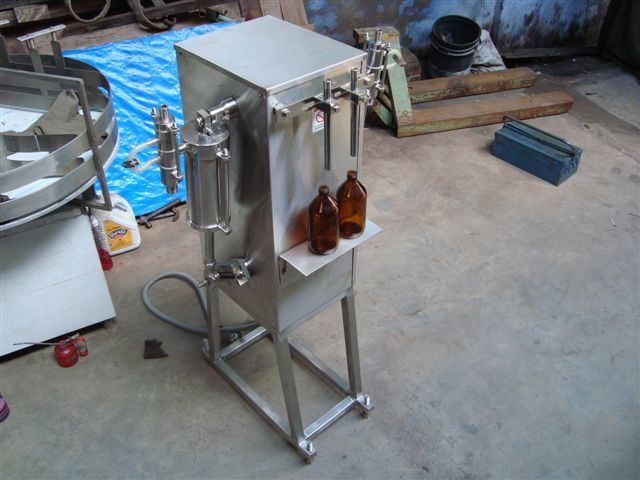 SEMI AUTOMATIC TWO HEAD FILLING MACHINE