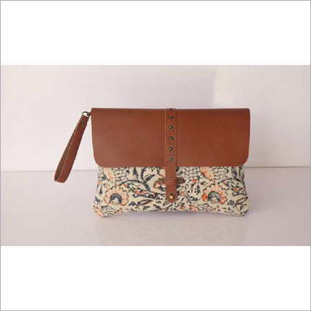 STYLISH COTTON RUG WRISTLET WITH LEATHER TRIM