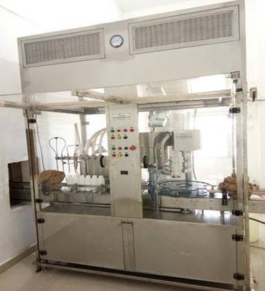 Monoblock Liquid Filler With Capper Along With Laminar Air Flow Cabinet