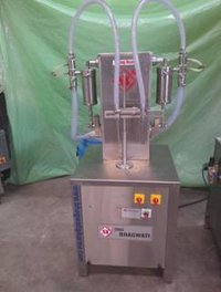 Semi Automatic Two Head Primer Adhesive Type Filling Machine