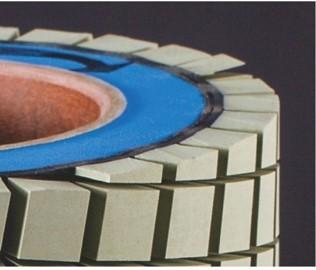 Ceramic brush roller for PCB scrubbing