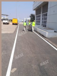 Line marking on bitumen surface