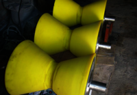 Rubber clad roller