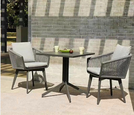 Outdoor aluminum table and rope chair with cushion pillows