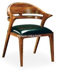 wooden chair with leather set top.