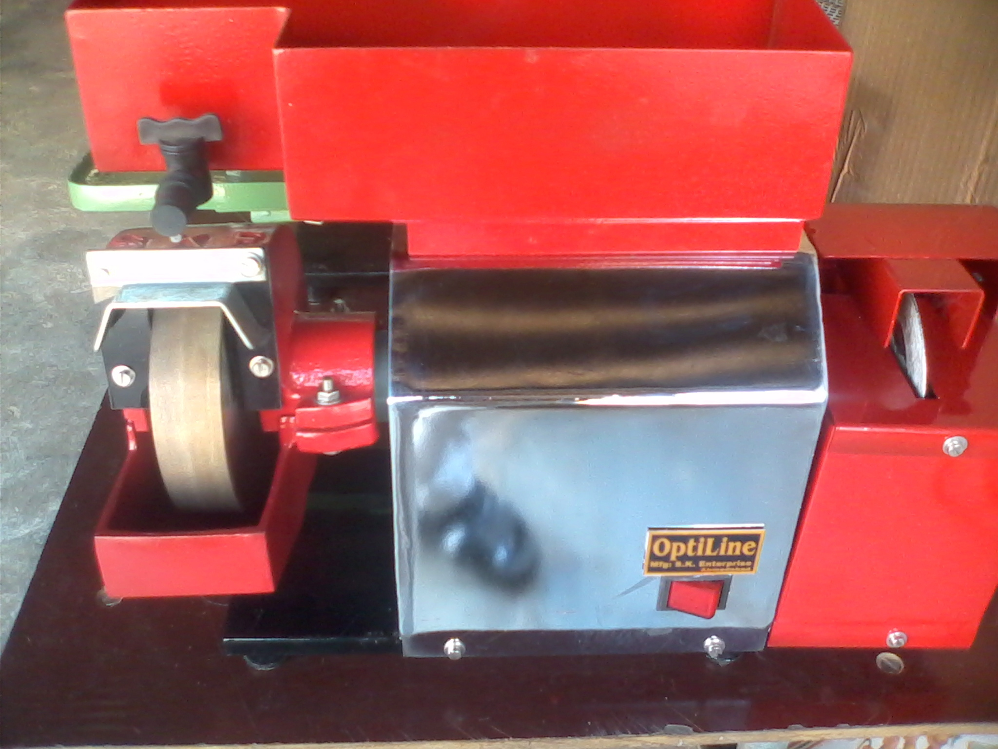 OPTICAL LENS EDGE CUTTING,GRINDING AND POLISHING MACHINE