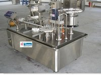 Rotary Filling, Stoppering And Capping Machine