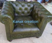 Single seater cheleather green sofa
