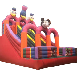 Kids Playing Inflatable Slide Castle