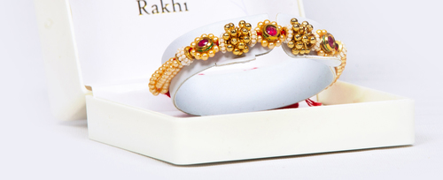 Moti rakhis with meenaballs