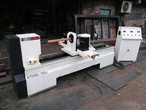 CNC TURNING  & ENGRAVING MACHINE