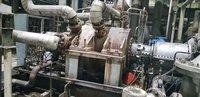 Online Condenser Helium Leak Testing