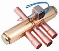 Four way reversible valve