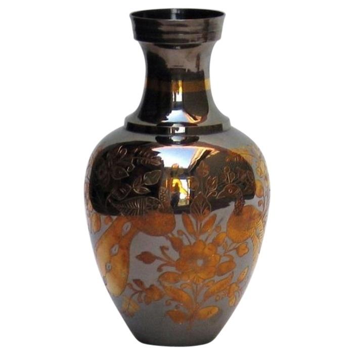 Brass vase orange floral design