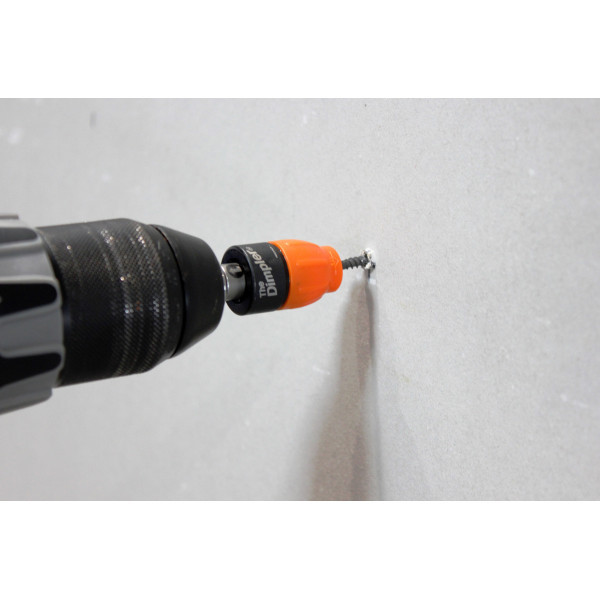 Magnetic drywall screw retainer