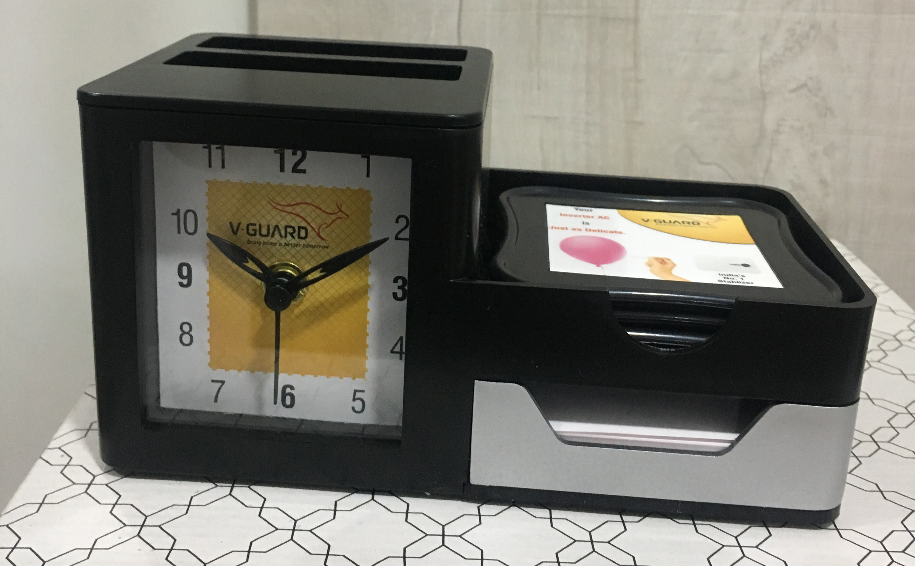 Promotional clock with pen stand