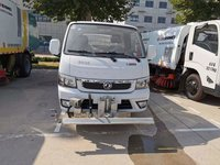 The Cleaning Of Pavement And Flyer Road Maintenance Vehicle