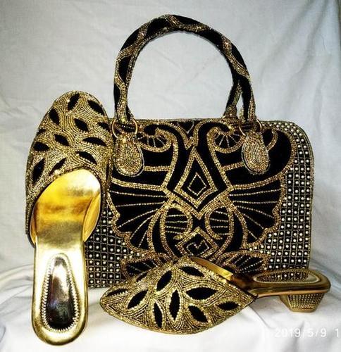 Black & golden shoes & bag