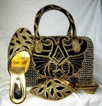 black & golden shoes & bag