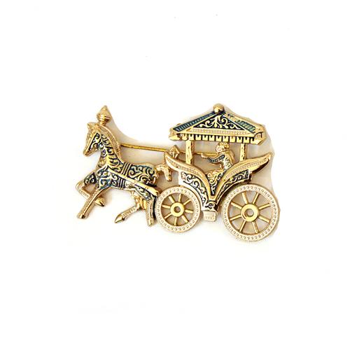 brass brooch