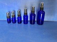 Blue glass spray bottles