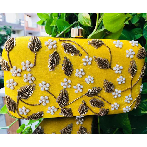 Embroidered crafted Yellow Clutch