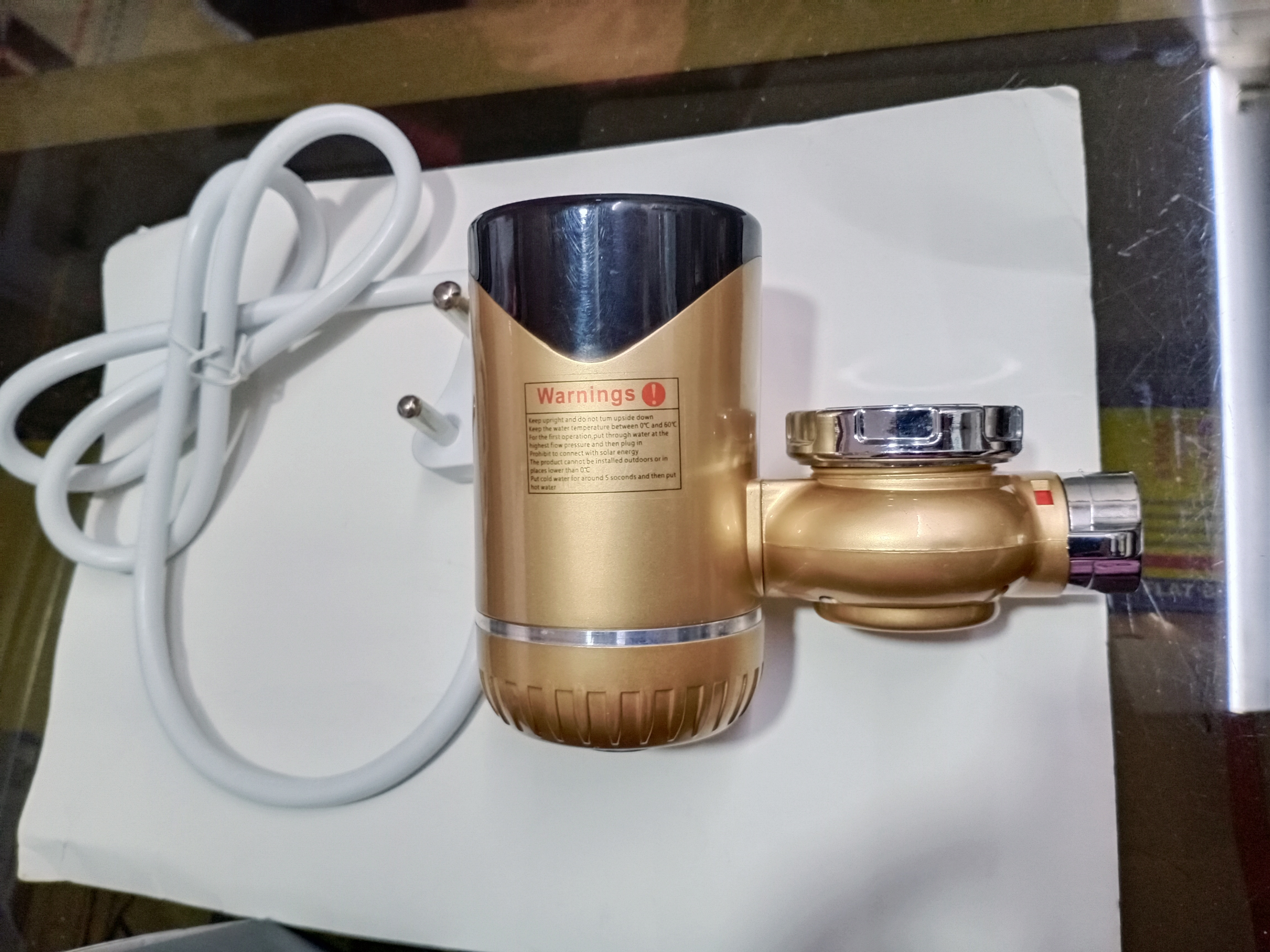 INSTANT HOT WATER DEVICE