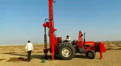TRACTOR MOUNTED AUGER DRILLING RIG