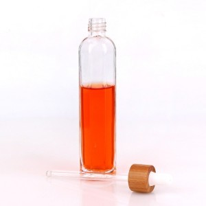 Wholesale 80ml glass cosmetic glass bottle with bamboo cap