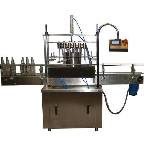 Four Head Volumetric Liquid Filling Machine