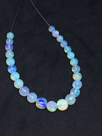 25 Carats Full Fire Ethiopian Opal Plain round Beads, 5-8mm, 6 inches strand