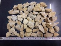 wholesale exporter of natural yellow marble lumps, aggregate and chips for landscaping