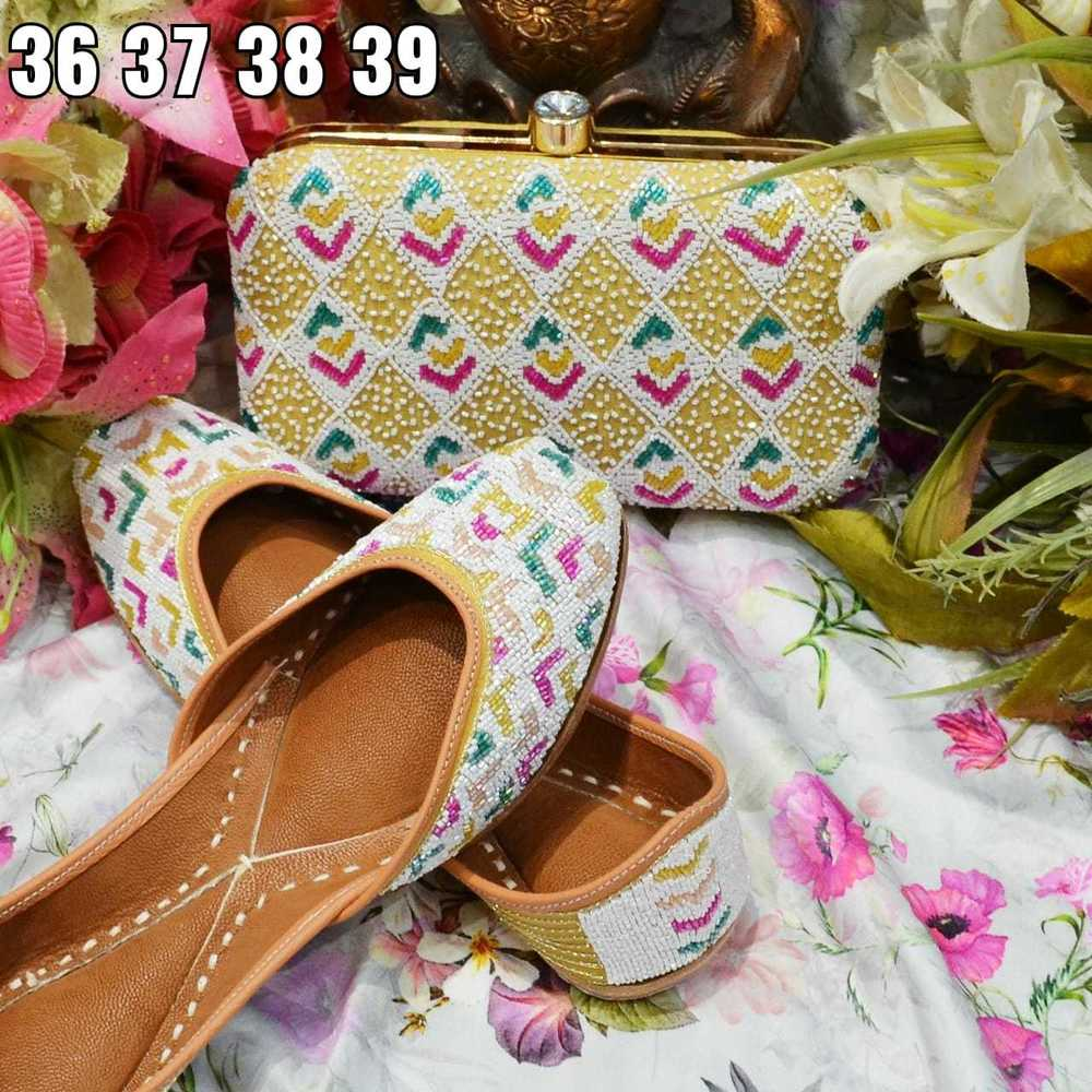 Party Wear Yellow Color Punjabi Jutti With Multi Preal Work With Maching Clutch