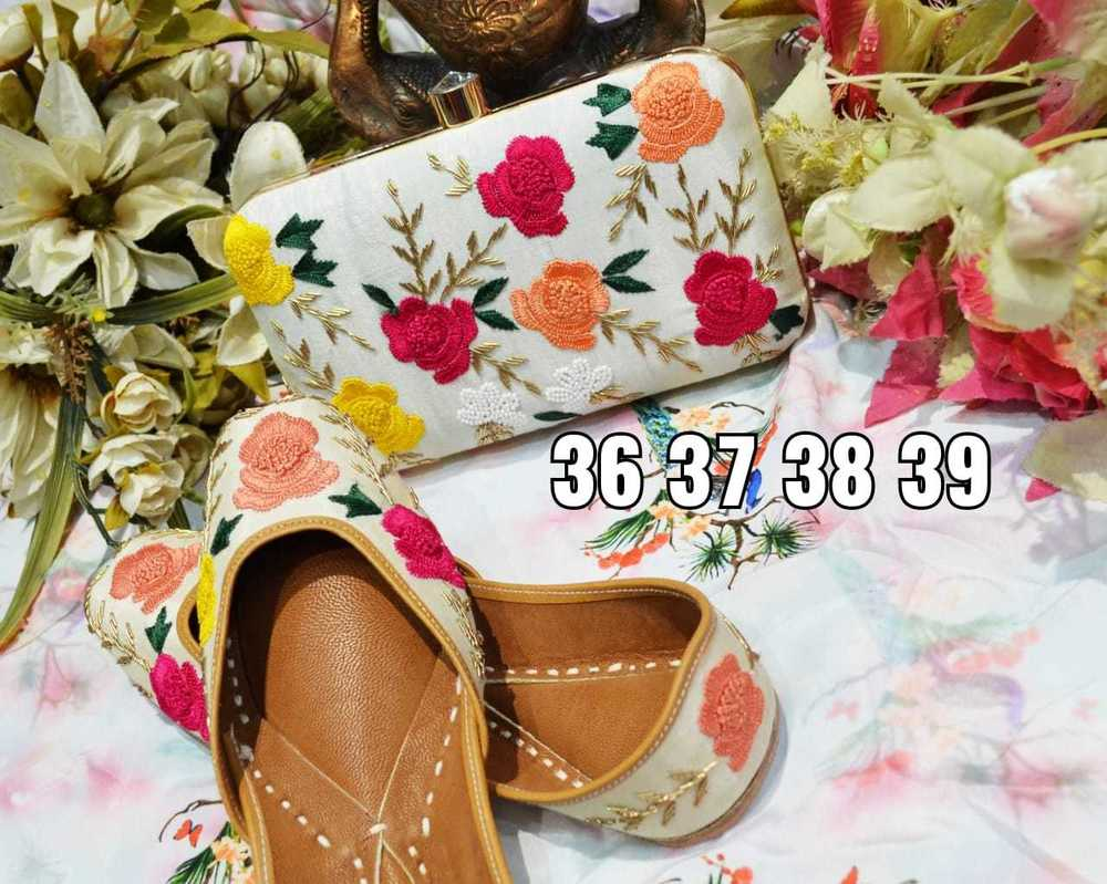 Partywear Punjabi Jutti White Colour With Flower Work With Maching Clutch