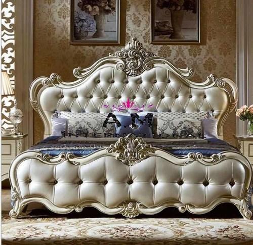 luxurious teak wooden bed