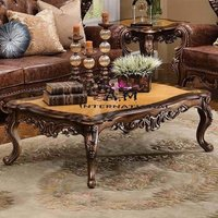 carved center table