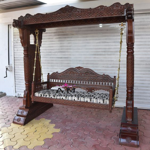 hand carved wooden swing