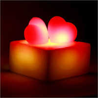Glowing Hearts Candle