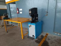 Foot operated brake shoe line riveting machine