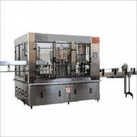 Rinsing, Filling And Capping Machine