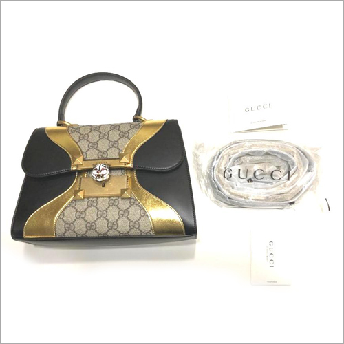 Gucci Black Gold GG Canvas Handbags