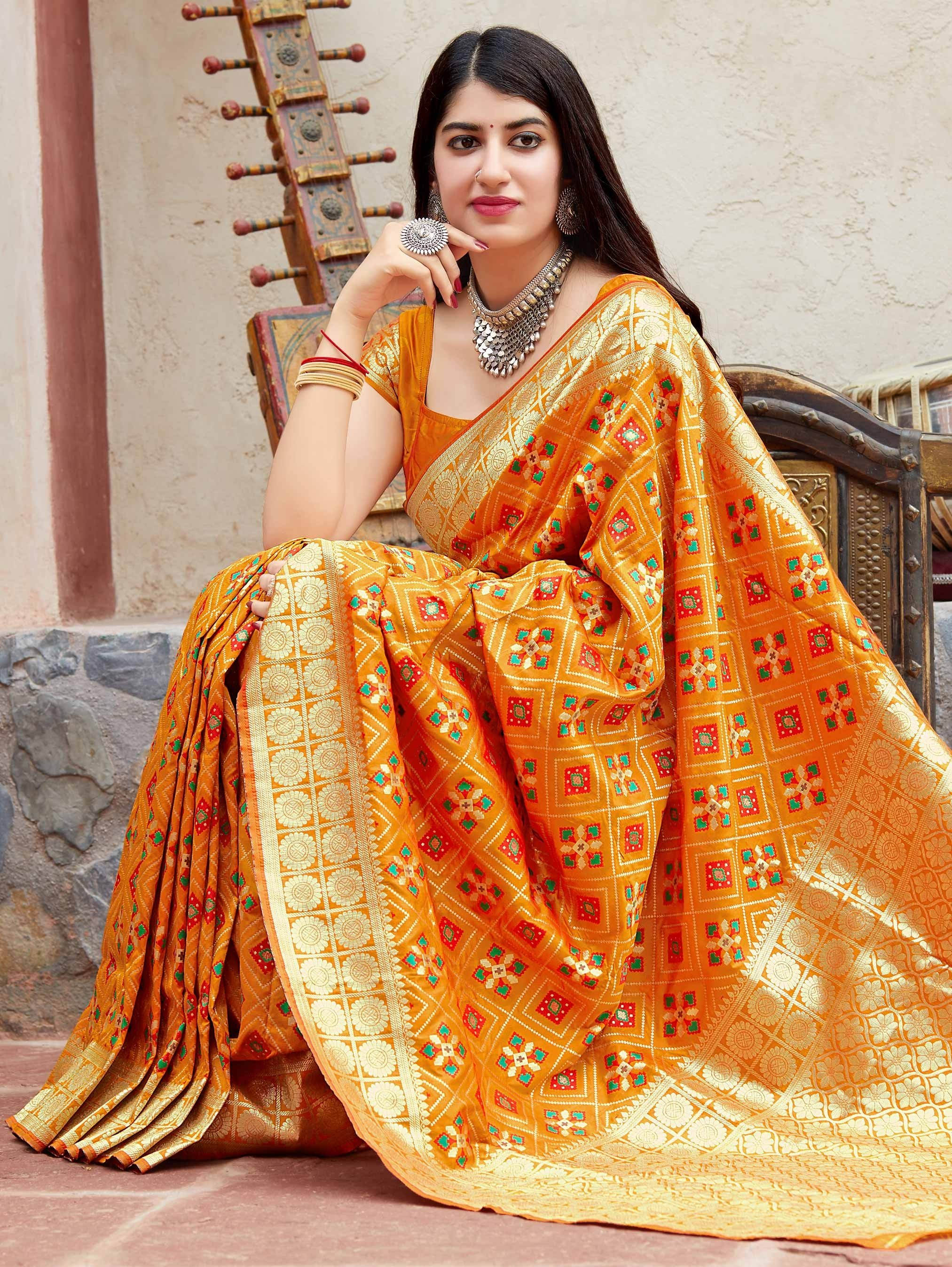 Mustard Yellow Banarasi Satin Silk Patola Print Woven Saree with Golden Border and Pallu